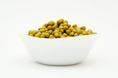 Conserved green peas in bowl. Stock Photography