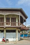 Conserved old mixed concrete and wooden shophouse in downtown Nakhon Phanom, Thailand Stock Photos
