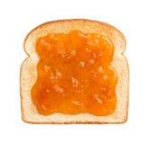 Conserves d'abricot sur le pain grillé photo stock