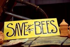 Conservi le api! Fotografia Stock