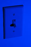 Conserving Power with Light Switch Off Royalty Free Stock Images