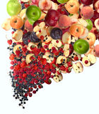 The considerable quantity of fruit falls downwards. Large quantity of ripe fruit and berries falling anavalanche in a bottom Stock Photography