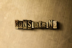 CONSIDERING - close-up of grungy vintage typeset word on metal backdrop. Royalty free stock illustration.  Can be used for online banner ads and direct mail Stock Photos