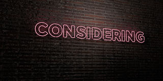 CONSIDERING -Realistic Neon Sign on Brick Wall background - 3D rendered royalty free stock image. Can be used for online banner ads and direct mailers Royalty Free Stock Images