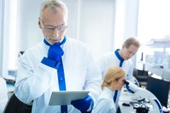 Serious researcher thinking about gene analysis Royalty Free Stock Image