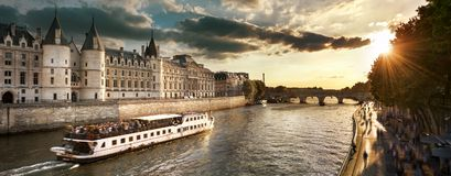 Boat tour on Seine river in Paris with sunset. Paris, France Royalty Free Stock Photo