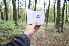 Consiga lejos, libro y texto Imagen de archivo libre de regalías