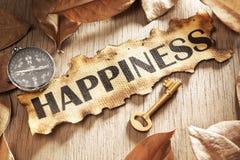 Consiglio e tasto al concetto di felicità immagine stock