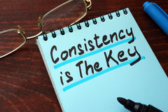 Consistency is The Key written on a notepad. royalty free stock image