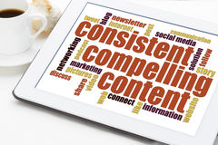 Consistent, compelling content. Recommendation for bloging and social media marketing - a word cloud on a digital tablet royalty free stock photography