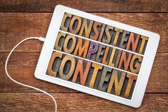 Consistent, compelling content on tablet. Consistent, compelling content - recommendation for bloging and social media marketing - a word abstract in vintage royalty free stock photo
