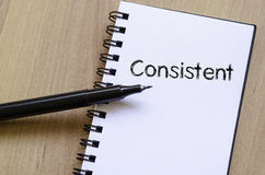Consistent write on notebook. Consistent text concept write on notebook with pen royalty free stock photo