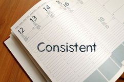 Consistent write on notebook. Consistent text concept write on notebook with pen stock photo
