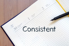 Consistent write on notebook. Consistent text concept write on notebook with pen royalty free stock photos