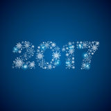 2017 consisting of snowflakes on blue background.  royalty free illustration
