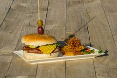 Still life of a burger on a plate royalty free stock image