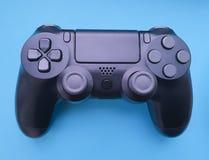 Consola coloreada digital del juego de las multimedias de la tecnología del papel del juego del negro del regulador del juego fotografía de archivo