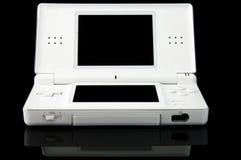 Consola portable de los juegos en el negro - frente fotografía de archivo libre de regalías