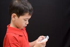 Console asiático do portable do miúdo Fotos de Stock