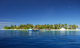 Console e barco tropicais Fotografia de Stock