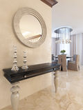 Console with mirror on the wall in the dining area, in the style Royalty Free Stock Photos