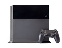 Console SONY PlayStation 4 with a joystick DualShock 4. Simferopol, Russia - August 8, 2014: Sony PlayStation 4 game console of the eighth generation. The Stock Photos