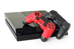 Console SONY PlayStation 4 with a joysticks. Sony PlayStation 4 game console of the eighth generation with a red and black joystick DualShock 4. The official Stock Photos