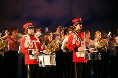 Consolidated children's orchestra of the Palace of youth Creativity and show of drummers in military uniform 18th. Royalty Free Stock Images