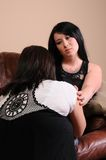 Consoling. A woman consoling her upset friend Stock Photo