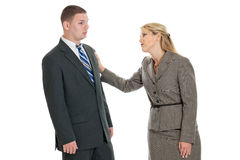 Consoling a colleague. A business women consoling a business men isolated on white Stock Photo