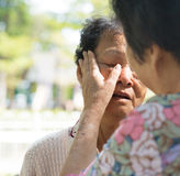 Consoling crying old mother Stock Photo