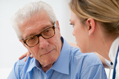 Consoling elder man. Sad and lonely senior men with nurse Royalty Free Stock Photos