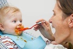 Consommation avec la maman Photographie stock libre de droits