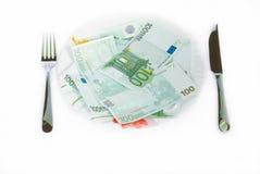 Consommation d'argent Photo libre de droits