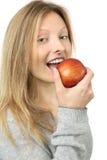 Consommation d'une pomme Photographie stock