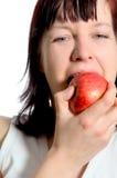 Consommation d'une pomme images libres de droits