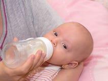 Consommation de bébé Photos libres de droits