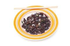Consommation de l'insecte image stock