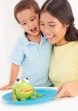 Consommation de mère et de fils Photographie stock libre de droits
