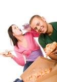 consommation des jeunes de femme de pizza d'homme Images libres de droits