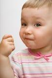 Consommation du bébé Photo stock