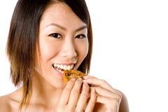 Consommation du biscuit Photographie stock libre de droits