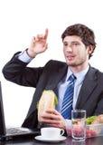 Consommation et augmenter d'homme d'affaires sa main Image libre de droits