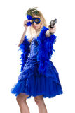 Conspiracy. Girl in a dark blue dress with a pistol and carnival a mask Stock Photos