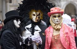The conspiracy of masks in Venice. The beauty of the masks and the beautiful city of Venice with its architecture Stock Photos