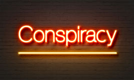 Conspiracy neon sign on brick wall background. Conspiracy neon sign on brick wall background stock images