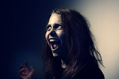 In Conspiracy With Satan. Girl possessed by a demon. In Conspiracy With Satan Stock Images