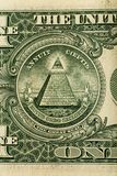 Conspiracy theory concept. All Seeing Eye and Pyramid on USA dollar banknote. Macro photo royalty free stock image