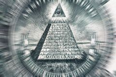 Conspiracy theory concept. All Seeing Eye and Pyramid on USA dollar banknote, macro photo. With motion blur effect stock image