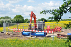 Consruction Site Compound. A fenced construction site compound in a meadow of yellow buttercups Royalty Free Stock Image